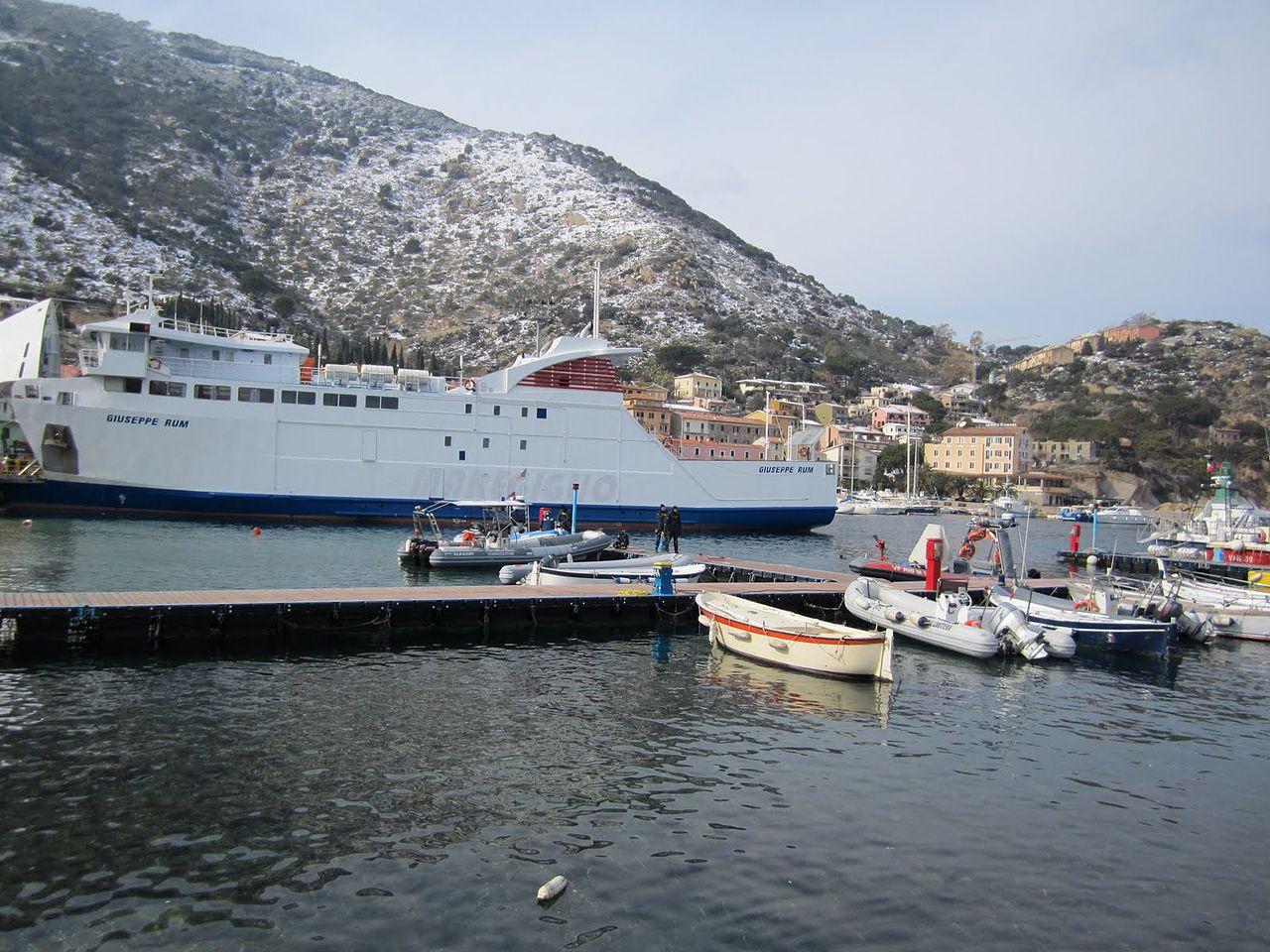 1280px-Ferry_Giuseppe_Rum_(IMO_9304954)_-_Port_of_Isola_del_Giglio_at_Giglio_Porto_-_Italy_-_12_Feb._2012